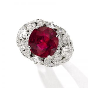 Superb 'pigeon blood' Burmese ruby and diamond ring, Cartier, set with a cushion-shaped ruby weighing 8.37 carats. From a Distinguished Private Collection.