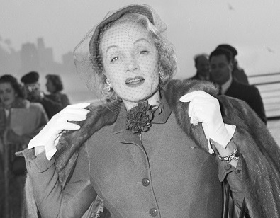 (Original Caption) 12/21/1950-New York, New York- Actress, Marlene Dietrich, unquestionably one of the most glamourous grandmothers in the world, shows herself to be little the worse for wear after her arrival at New York aboard the Queen Elizabeth.